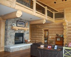 Another handcrafted log home in southern Ontario  #loghomes #loghomedesign #handcraftedloghomes #fireplace  For more photos of this or more of my designs, please check out my website, www.designma.com, my Design Page, www.facebook.com/loghomedesign