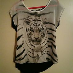 Animal Shirt Bring out your wild side with this beautiful tiger shirt. The back side is longer so it covers up your bum some. Dots Tops Tees - Short Sleeve