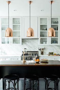 katie martinez kitchen design - marble splash back/copper pendant lights