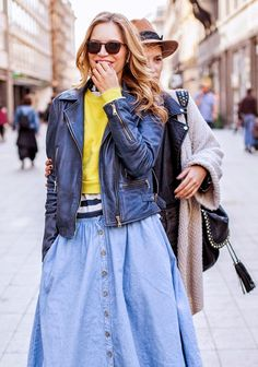 Yellow cropped sweater, leather jacket, and denim skirt