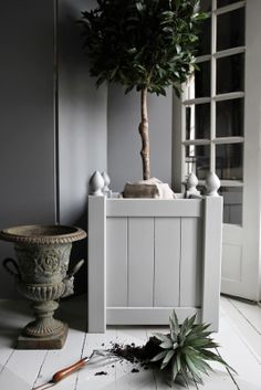Gray container &  urns ...very French