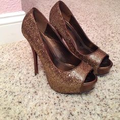 Gold & bronze glittery peep toe pumps Pumps have been worn twice and are in great condition. I scuffed up the back of the right shoe a little, but when they're on its not visible. Shown in pictures :) Shoes Heels