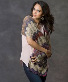 This intriguing shawl is easy to knit thanks to the amazing way that the yarn changes textures and color as you knit with it. You'll enjoy the way it makes an ordinary outfit, become extraordinary. It's a nice gift idea, too!
