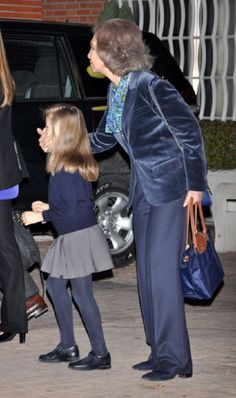 "Queen Sofia must be playing ""guess who"" game to her grand daughter Infanta Leonor at La Milagrosa Hospital parking lot to visit the King."