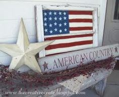 Old wood window with flag, on a prim white bench! Cute