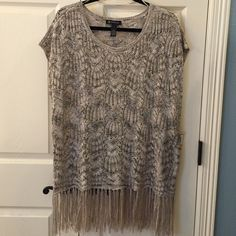"INC International Concepts Metallic Poncho Sweater Beautiful poncho like, lightweight sweater. There are tiny sequins and silver thread woven in. Not real sparkly. Couldn't get it to show in pictures. Sides are split about 7"" from bottom.  Fringe on bottom. INC International Concepts Sweaters Shrugs & Ponchos"