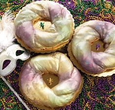 King Cake | A ring of twisted, buttery dough sweetened with cinnamon and sugar and filled with a whipped cream cheese filling. Long live the king.