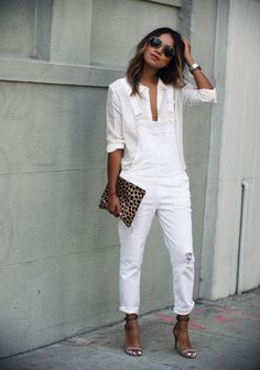 Summer Fashion | What to Wear With White Jeans - Style white overalls with a loose fitting blouse, minimalist sandals, and cool printed accessory like this leopard clutch @stylecaster