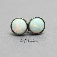 These opal stud earrings are beautiful. They feature a single 6mm simulated opal cabochon. Completely handmade in my studio using all sterling silver. I have hand soldered the bezels to the studs and