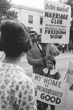 """""""Inter-racial Marriage Club of Washington, D.C. Naturally Wants Freedom Now""""  """"My home is desegregated. It's good.""""  Members of the Interracial Marriage Club are shown here protesting bans on interracial unions and advocating for desegregated homes.  Source: National Archives, Records of the United States Information Agency"""