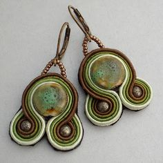I just listed these new earrings in my etsy shop.I've been doing a lot of experimenting with silk soutache trim the last few weeks. I ordered many yards of the trim for an on-line supplier. They had the most beautiful colors. I love earthy colors especially greens. The trim was a perfect match to th