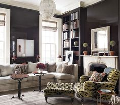 living room with black lacquer walls