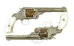 """Very Rare Presentation Pair of Smith & Wesson Engraved New Model No. 3 Single Action Revolvers in .44 Russian caliber & 6 1/2"""" barrels. Nickel finish with gold plated cylinders and outstanding full coverage New York style engraving. Wonderful smooth mother of pearl stocks."""