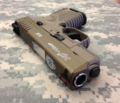 XDS .45 with a FDE frame and a Burnt bronze cerakoted slide.