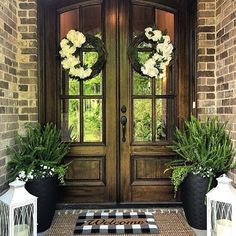 I would love to have this double door entry to my home - such a gorgeous front porch!!