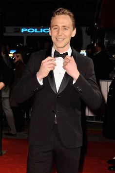 """Tom Hiddleston. This just makes me think of the Doctor straightening his bow tie before saying that """"Bow ties are cool."""" Police is even in the background! Make him the 12th Doctor!"""