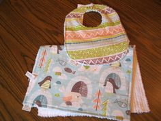 A personal favorite from my Etsy shop https://www.etsy.com/listing/201450234/baby-bib-and-burp-cloth-set-adorable