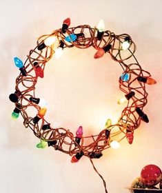 Wire wreath wrapped with retro, oversized Christmas lights. I have lights packed away in storage waiting to make one of these this year.