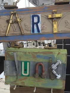 """""""The Art of Junk"""" home decor. Two seperate signs made from salvaged barn wood,layered with scrap metal of pressed tin ceiling tiles. Words spelled using various reclaimed hardware pieces: hinges,folding wood ruler,license plate letters.  JunkChic 5280"""