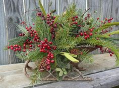 Winter / Christmas Floral Arrangement - Arrangement in Sleigh with Berries and Artificial Greenery - Beautiful Centerpiece via Etsy.