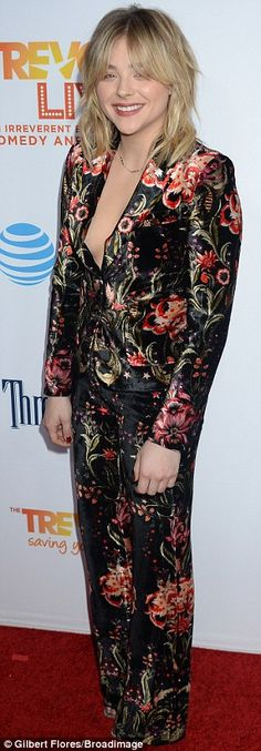 Smiles all around: The If I Stay star chose a black, red and gold blazer and matching bott...