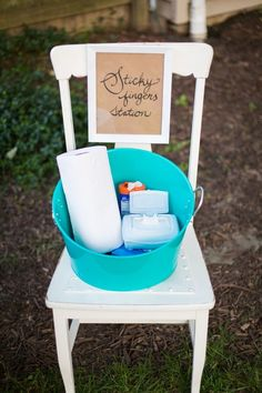 Outdoors Party Tip: The Sticky Fingers Stationr: a bucket of hand wipes, paper towels, and bug spray. All of which went to good use throughout the evening!.