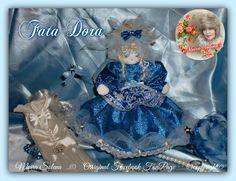 FATA DORA. Bella, azzurra e scintillante, cucita a mano su stoffa laminata con bordura in tulle e stelline applicate singolarmente...PROFUMATA CON DELICATE ESSENZE.