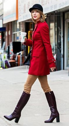 Taylor Swift's NYC winter style is on-point. // wearing a red coat, riding pants, and tall boots