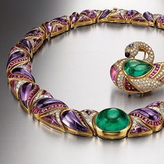 Brilliant colour is a mark of BVLGARI HERITAGE collection, magnificent as ever and breathtaking in its bold beauty. NECKLACE and BROOCH with EMERALDS, AMETHYSTS,RUBIES and DIAMONDS. Circa1989.