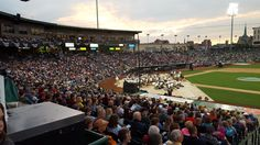 The Fort Wayne Philharmonic playing in Parkview Field at dusk. The evening ended with them accompanying the fireworks display. Great night at the ballpark!!