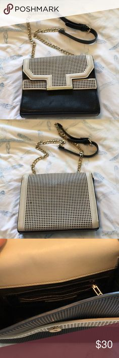 Zara crossbody or shoulder bag Stylish design that is spacious too! Adjustable strap so it may be worn crossbody or over the shoulder. Black and white so it matches everything! Lightly used. Zara Bags Shoulder Bags
