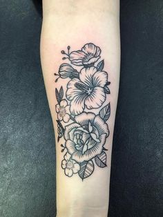 Floral tattoo by Greg at Holy Trinity Tattoos
