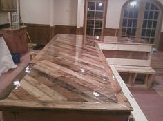 Kitchen counters out of pallets - no instructions - idea only.  Obviously choosing non-chemically coated wood, and then making sure your sealant is food safe, are imporant steps.