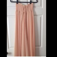 Free People Peach Maxi Dress/Skirt When I wore this (once) I wore it as a high waisted maxi skirt but then I found it online and it's actually a knee length strapless dress. I'd say it could be worn either way! Would probably hit the floor on someone short as a dress Free People Dresses Maxi