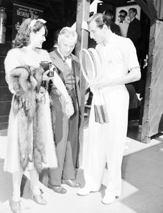 Charlie Chaplin with Paulette Goddard and British tennis player Fred Perry, c. 1935.