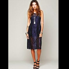Free People blue black Miracle Lace Midi Dress X/S Free People blue black Miracle Lace Midi Dress Sheer lace mid length body consiuous black & purple blue lace Racerback back is sheer and above bust is sheer, lined to mini length  black scalloped lace trimming around all edges and black lace inserted around the skirt of the dress pullover style * this dress does not have spandex in it but it does stretch New Without Tags  *  Size:  X Small    60% poly * 40% nylon Machine Wash Cold  Import…