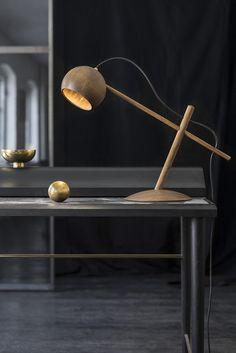 The Lune Pendant Lamp represents a fusion of woodturning tradition, natural materials and modern technology. The perfectly rounded shade made out of solid oak is beautifully contrasted by the contemporary LED light source. The result is a modern lamp with Desk Lamp, Table Lamp, Gold Interior, Interior Design, Wooden Lamp, Scandinavian Interior, Wood Turning, Lamp Light, Lighting Design