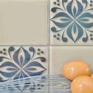 """Tile Tattoos, removable tile """"stickers"""" to add drama to plain tiles or cover up out-dated tiles/cracked tiles.  Great idea!"""