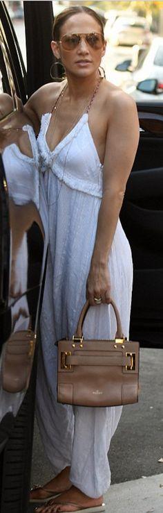Jennifer Lopez: Bracelet – Cartier Purse – Valentino Shoes – Havaianas Earrings – Lana Jewelry