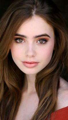 Lily Collins- flushed, bold brows and there's something awesome going on with her eyeshadow that I can't quite figure out.