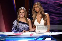 Gymnast Shawn Johnson (L) and TV personality Kim Kardashian speak onstage during the Teen Choice Awards 2009 held at the Gibson Amphitheatre on August 9, 2009 in Universal City, California.