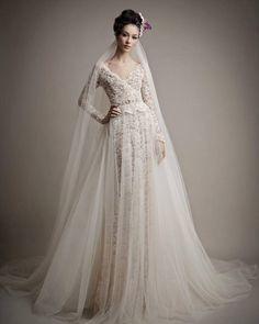 Wedding dresses | F&L's #White #Wedding Ideas http://www.pinterest.com/FLDesignerGuide/white-wedding/