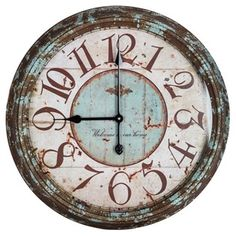 "It's time to upgrade that boring home décor. Use this Large Rusty Turquoise Round Metal Wall Clock to achieve the ultimate shabby-chic look! Featuring a rusty turquoise metal construction, a beautiful brown face with coordinating turquoise and rust accents, the words, ""Welcome to our home,"" in a sophisticated script, and a clear glass face, this beautiful wall clock will add charm and interest to your living room, bedroom or kitchen.    	Dimensions:    	  		Width: 24""  	  		Thickness: 3""…"