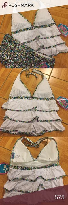 NWT COCO RAVE Bathing Suit Top and Bottom COCO RAVE Tankini Set! Top and bottom are brand new, with tags!  Top: •Size: L 36 C Cup •Removable Padding •White with Ruffles and Floral Pattern •90% Meryl Nylon/ 10% Spandex  Bottom: •Size: XL •Matching floral Pattern  •Skirted/ Boy Short Cut •Still has panty liner inside!  •90% Meryl Nylon/ 10% Spandex  👾NO TRADES 👾OFFERS WELCOMED! 👾BUNDLE TO SAVE  👾FEEL FREE TO ASK ANY QUESTIONS Coco Rave Swim