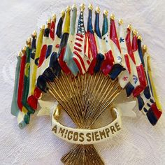 Coro WWII Brooch, Emblem of the Americas, Amigos Siempre Pin, Brunialti Book piece, Vintage Military Jewelry  1941 Coro  Emblem of the Americas  brooch / Pin. The pin is 21 enameled flags. They represent the countries of the Americas with the US flag in the middle. The ribbon #ribbons #flags #worldflags