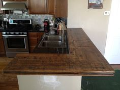 Counter top made out of old box car wood. Wood is from Reclaimed Design Works. Counter top hand crafted by Jason Faust.