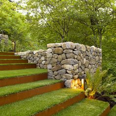 Stone wall and corten steel & grass steps