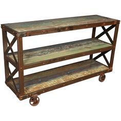 We love the functionality of this four wheeled reclaimed wood and metal trolley side table. With two shelves for storage, it features reclaimed wood, industrial metal rivets and architectural cross bars. A fun industrial piece with vintage appeal.