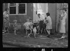 Poor children playing on sidewalk, Georgetown, Washington, D.C. Sept 1935
