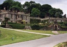 Tissington Hall, Derbyshire - built in 1609, it remains in the ownership of the original owners' family. The atmosphere in room 4 is oppressive to depressing, and is sometimes violent. The ghost is suspected to be that of a girl who died from injuries suffered when her nightgown caught fire from a candle flame. Unexplained noises and severe temperature drops plague the library, and a black shape haunts the cellar area and surrounding corridors. Also reported are phantom smells and spirit…